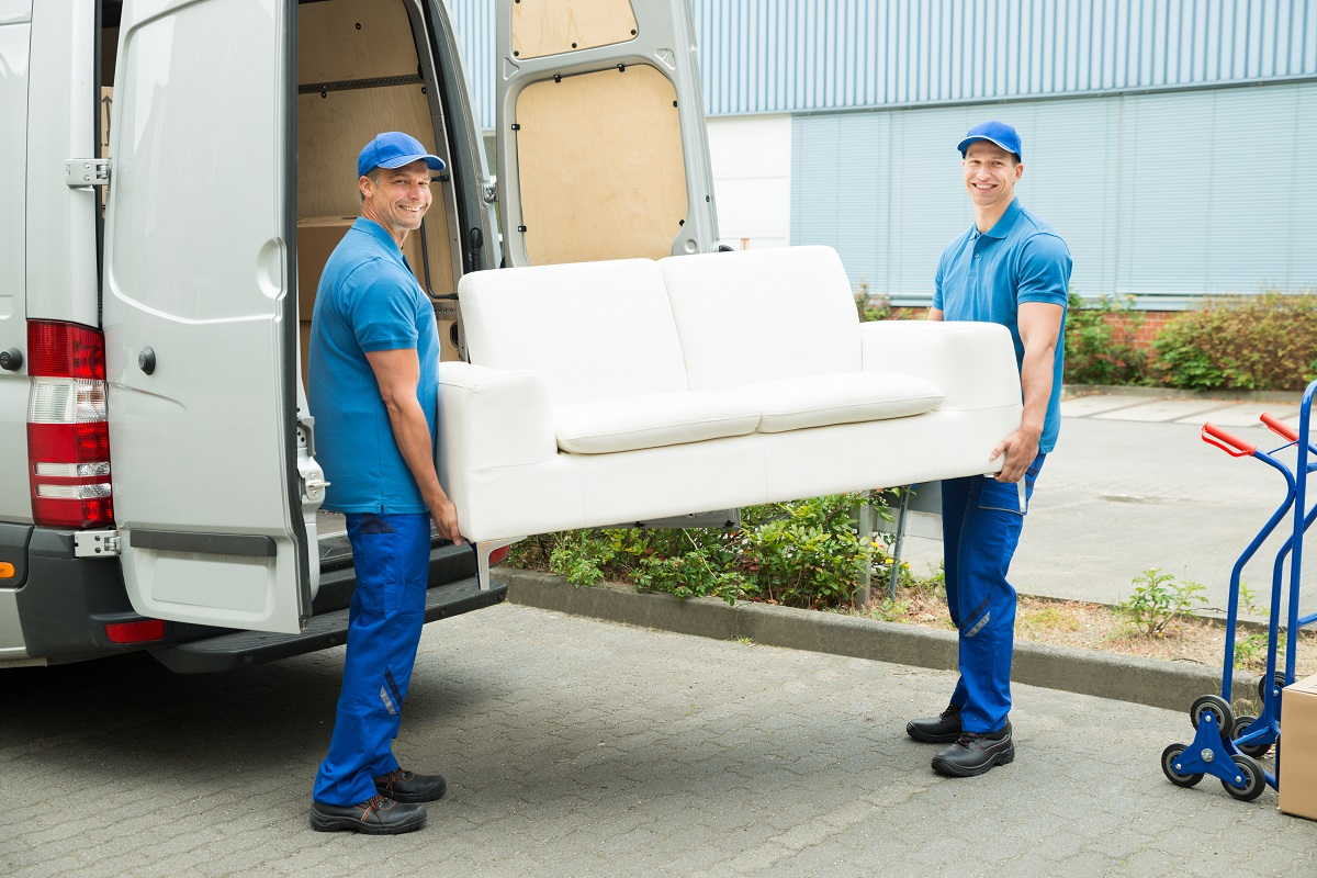 Movers putting the couch in the sprinter van