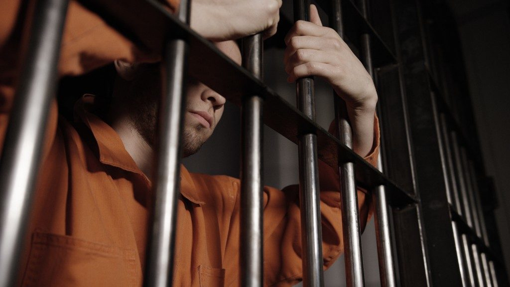 Man inside prison cell