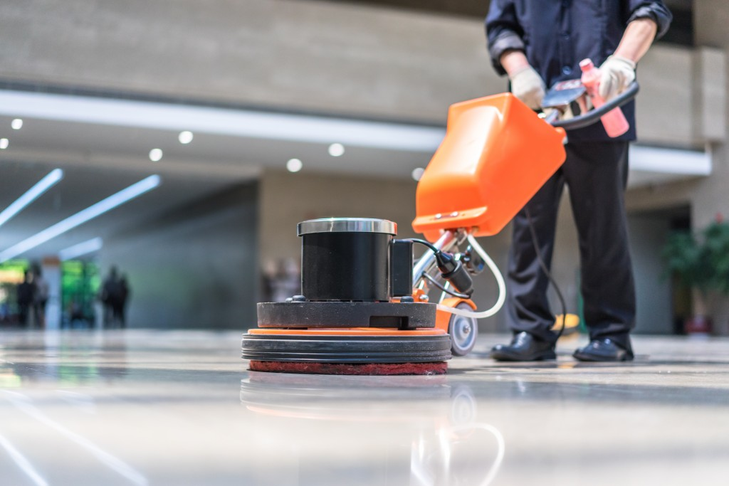 Professional cleaner polishing floor