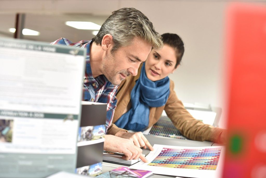 industrial printing expert with client