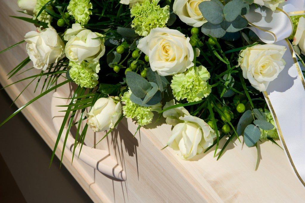 coffin with a flower arrangement