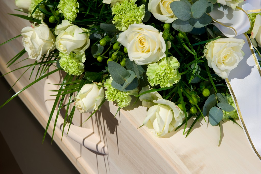 coffin with a flower arrangement