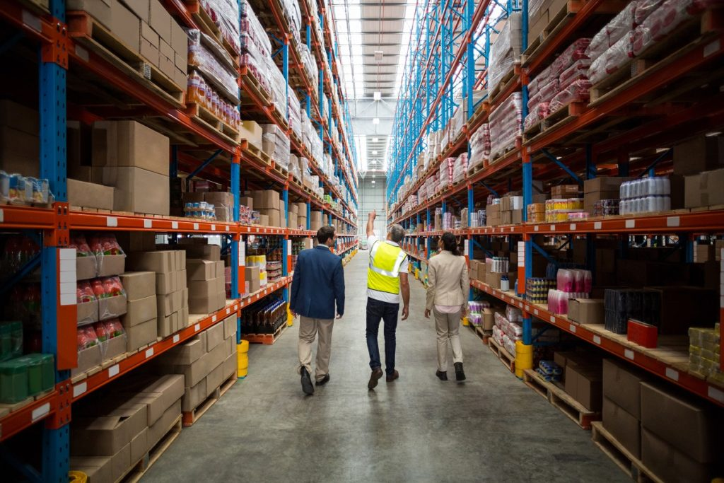 employees walking around the warehouse