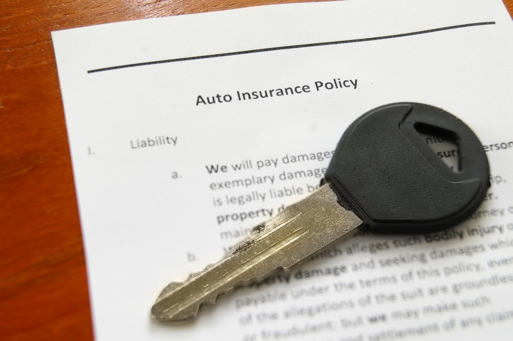 car keys and auto insurance policy