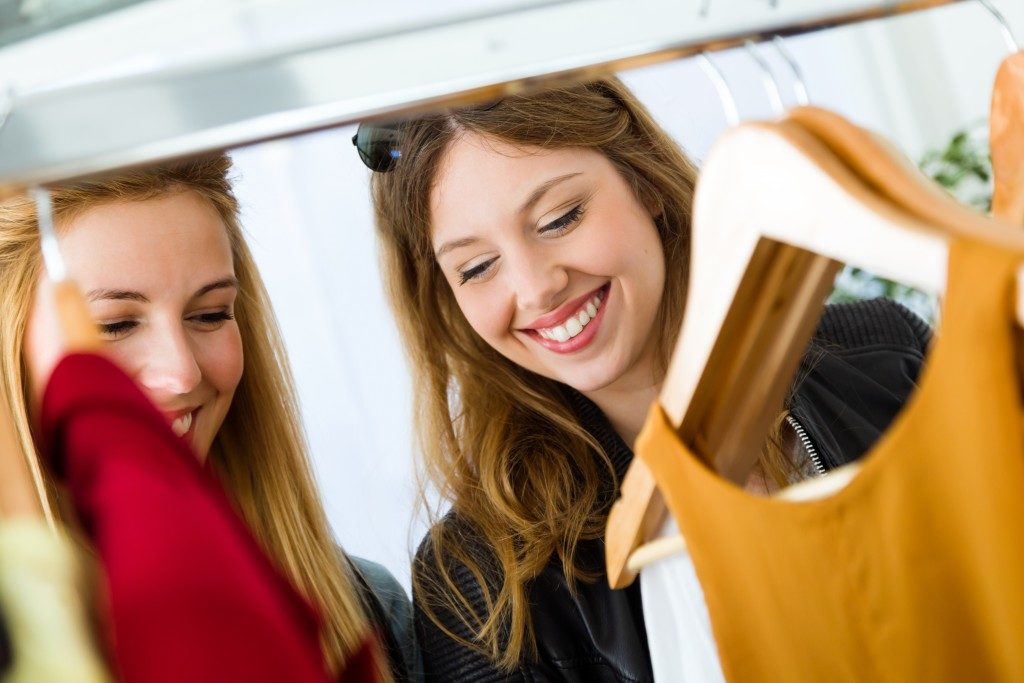 two women shopping for clothes