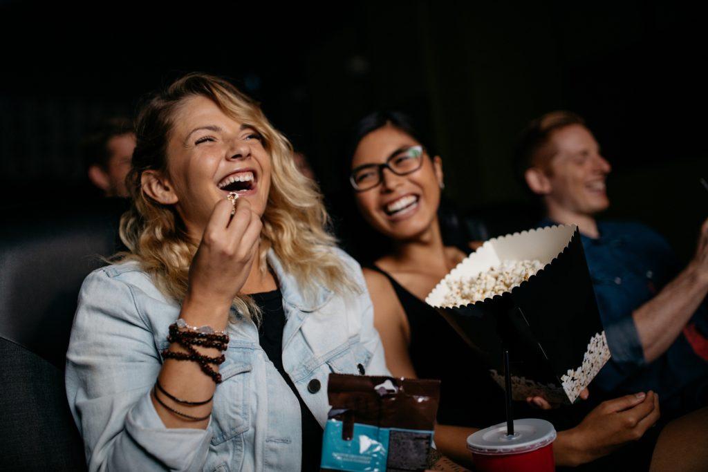 woman laughing at cinema