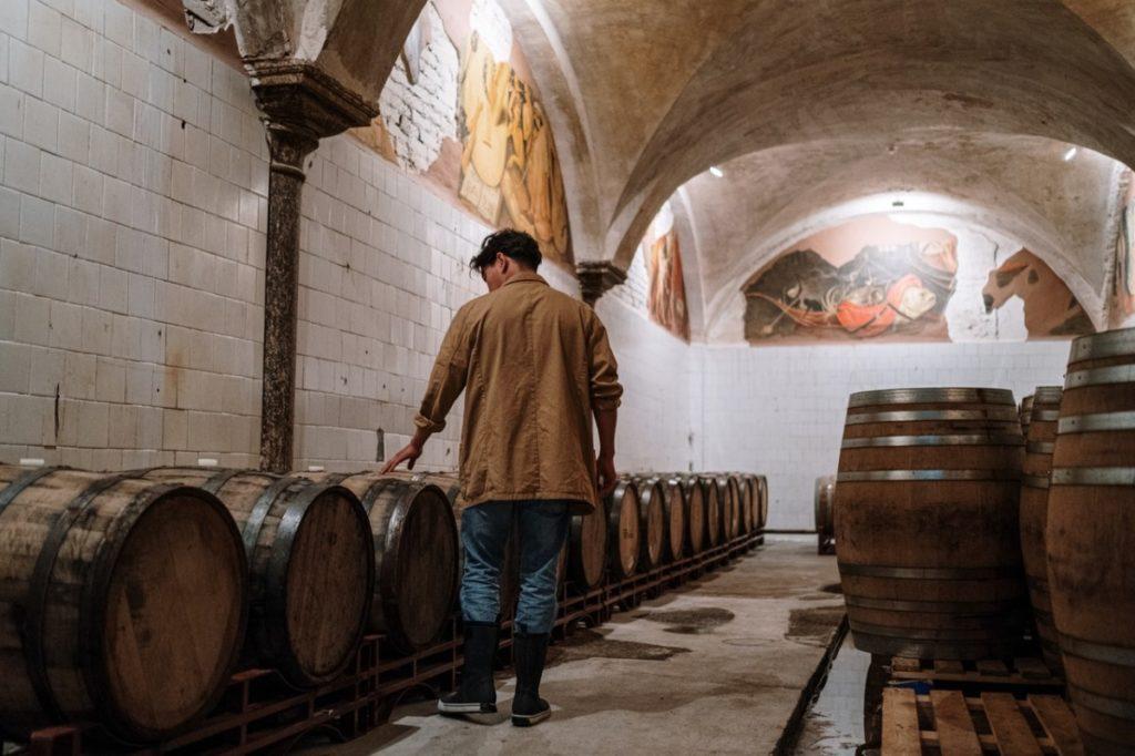 man with barrels