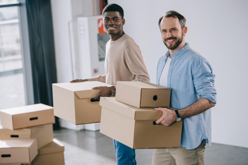 men holding boxes