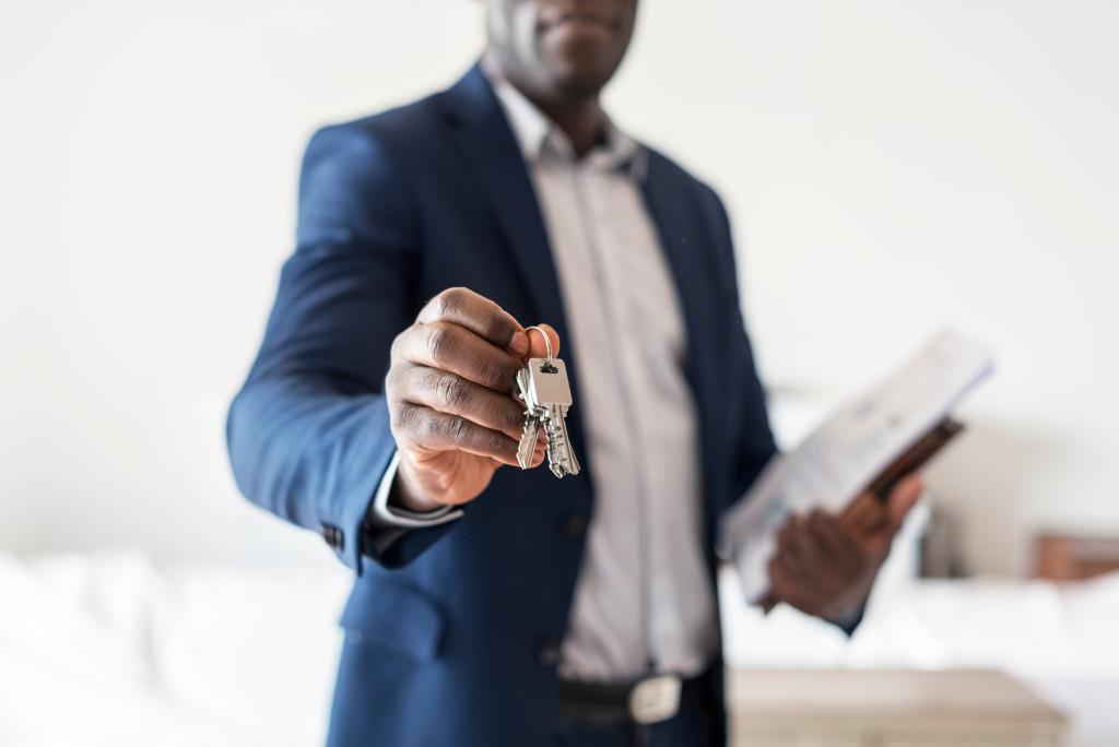 real estate agent holding keys