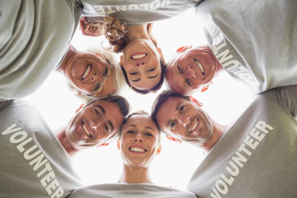 volunteers in a huddle