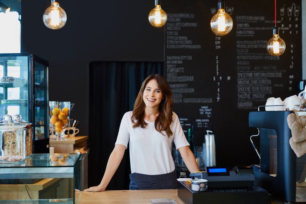 a woman standing on a counter of a business