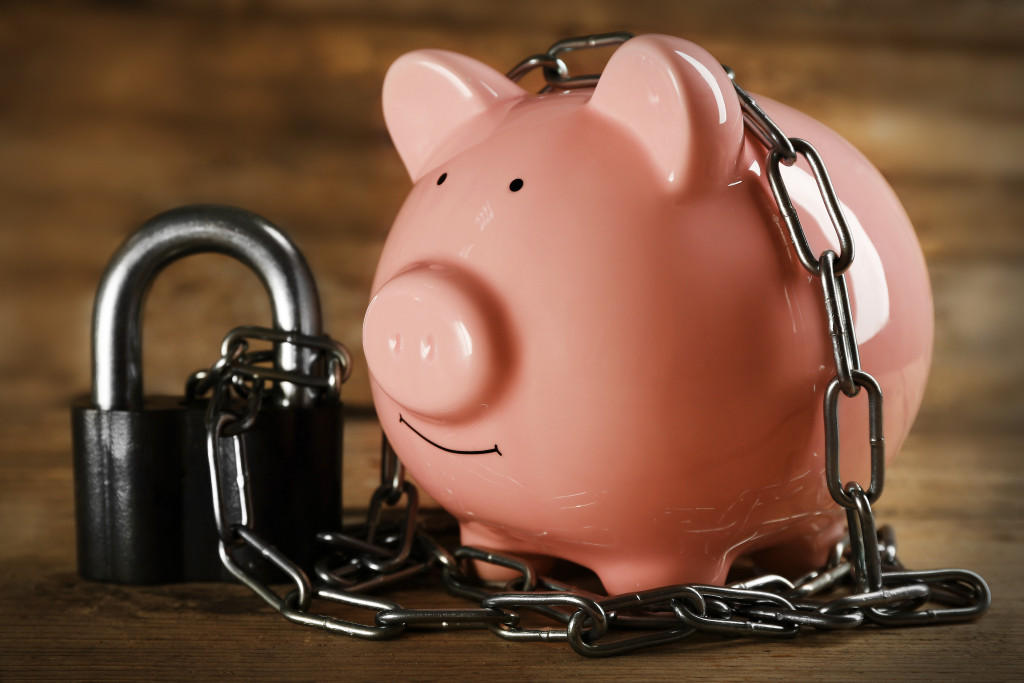 piggybank with a chain
